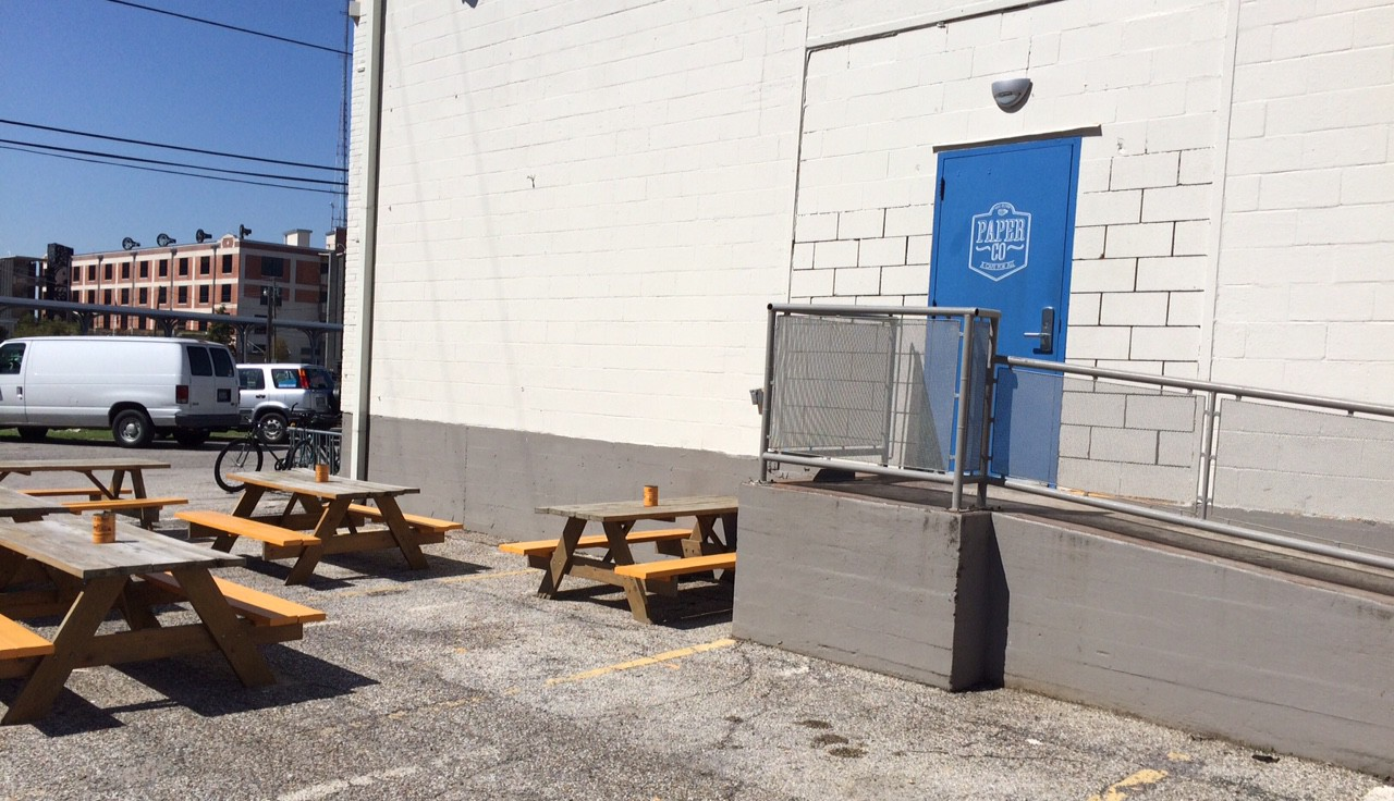 Blue door of Paper Co Coffee in East Downtown Houston