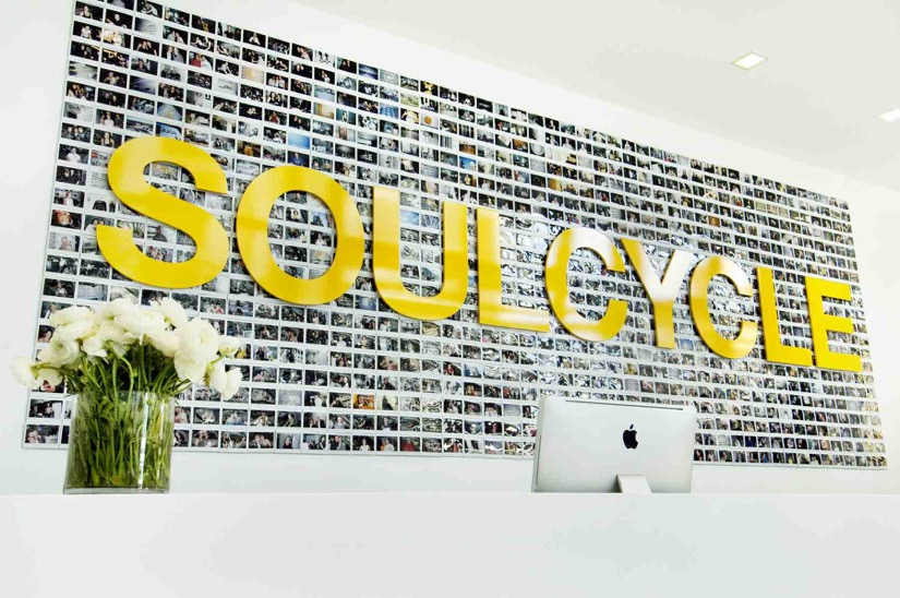 SoulCycle sign behind the reception at SoulCycle Houston River Oaks